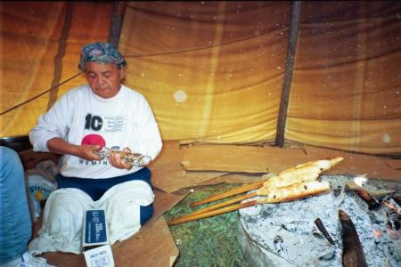 Cooking bannock in a teepee